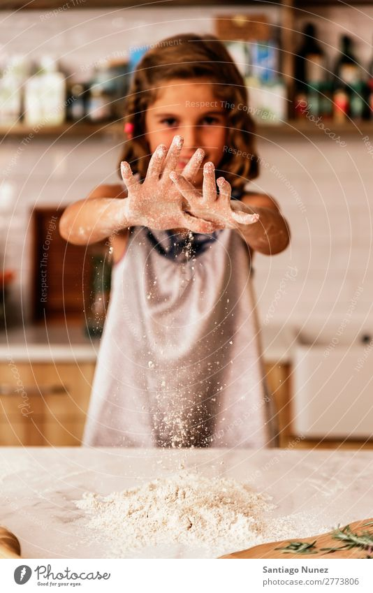 Little child girl kneading dough prepare for baking cookies. Child Girl Cook Cooking Kitchen Flour Chocolate Daughter Day Happy Joy Family & Relations Love