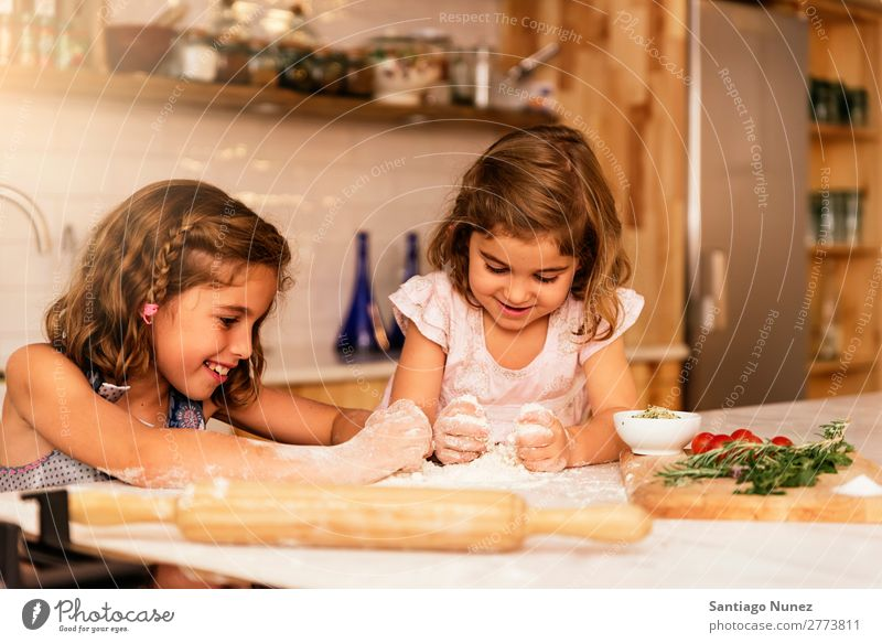 Little sisters girl preparing baking cookies. Child Girl Cooking Kitchen Flour Dough Baking Chocolate Ice cream Strawberry Daughter Day Happy Joy