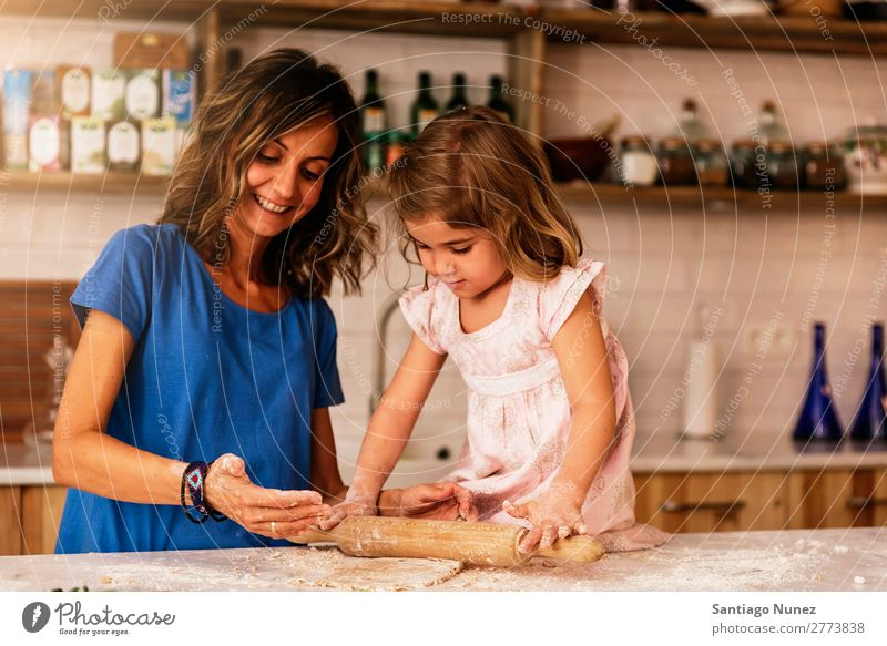 Little child girl kneading dough prepare for baking cookies. Mother Girl Cook Cooking Kitchen Flour Daughter Day Happy Joy Family & Relations Love Baking Food