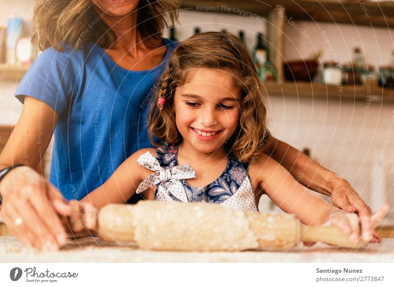 Little child girl kneading dough prepare for baking cookies. Mother Girl Cook Cooking Kitchen Flour Chocolate Daughter Day Happy Joy Family & Relations Love