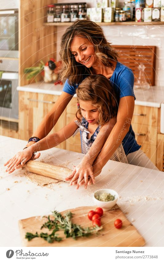 Little child girl kneading dough prepare for baking cookies. Mother Girl Cook Cooking Kitchen Flour Chocolate Daughter Dough Day Happy Joy Family & Relations