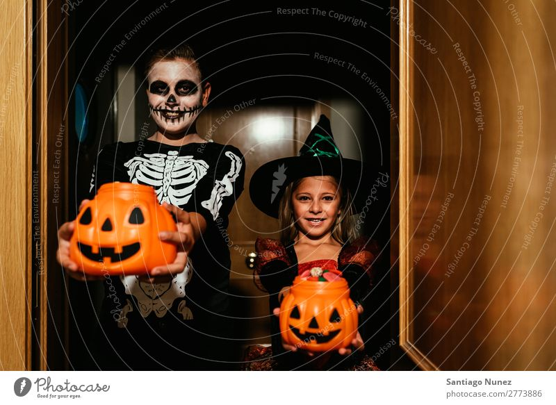 Happy children disguised saying trick or treating. Hallowe'en Child Girl Boy (child) Painting (action, artwork) Skeleton Witch Disguised Joy Family & Relations
