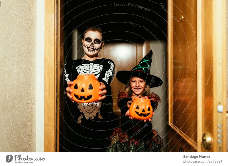 Happy children disguised saying trick or treating. Hallowe'en Child Girl Boy (child) Painting (action, artwork) Skeleton Witch