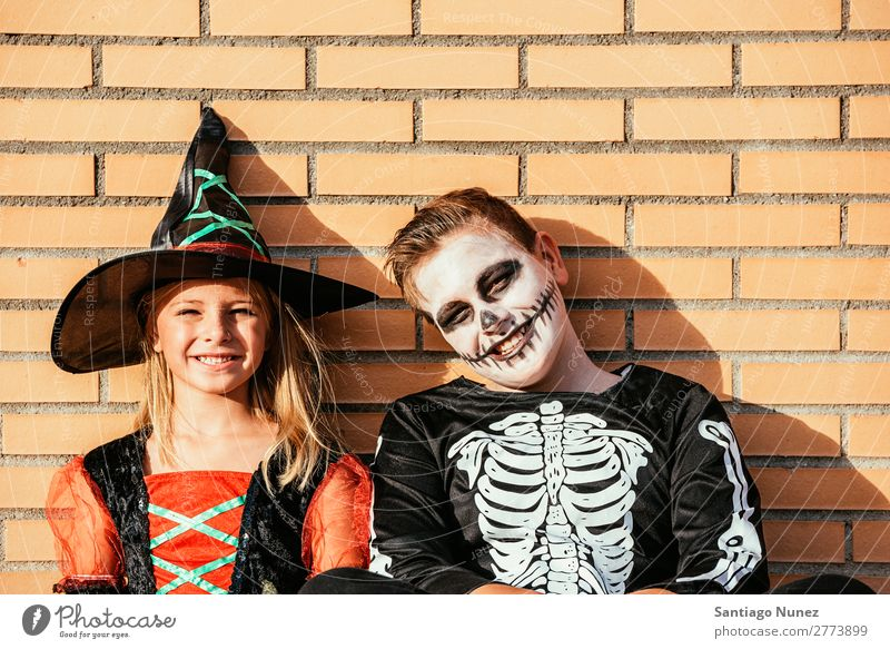 Portrait of children disguised in the street. Hallowe'en Child Girl Boy (child) Painting (action, artwork) Skeleton Witch Joy Family & Relations Sister