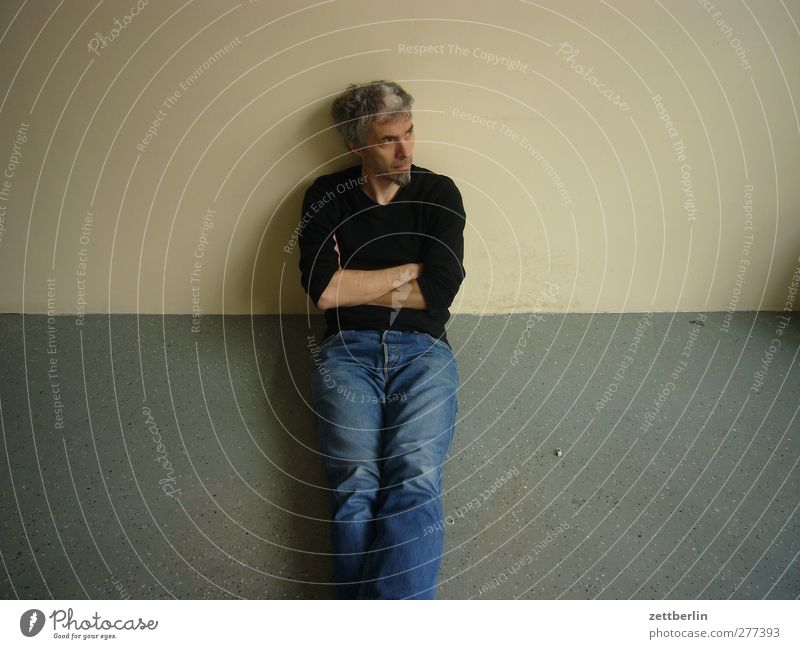 Human being Man Adults Wall (building) Sadness Flat (apartment) Sit Leisure and hobbies Wait Masculine Living or residing Floor covering 45 - 60 years Jeans Facial hair Fatigue