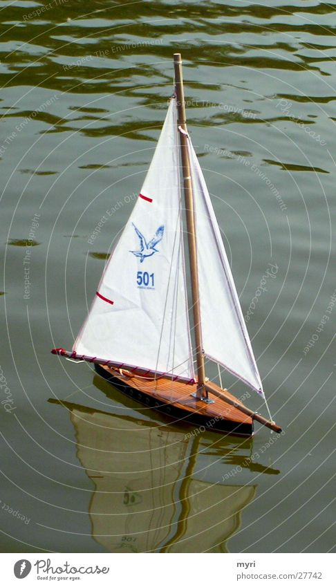 sailboat Lake Watercraft Sailboat Sailing Reflection Paris Park Leisure and hobbies Pattern Green water