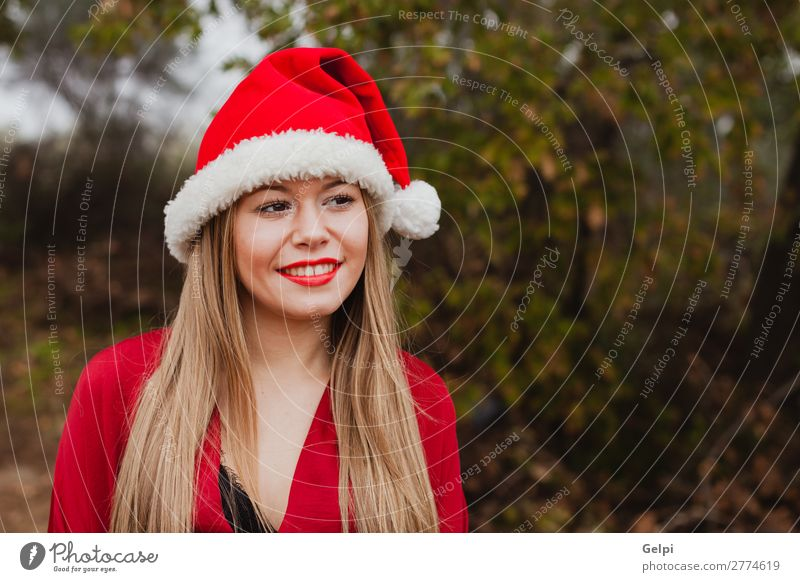 Young woman with Christmas hat in the forest Woman Human being Nature Christmas & Advent Beautiful White Red Tree Calm Joy Forest Winter Face Lifestyle Adults