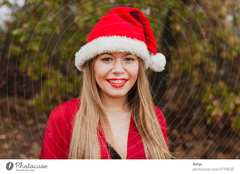 Young woman with Christmas hat in the forest Lifestyle Joy Happy Beautiful Face Calm Winter Christmas & Advent Human being Woman Adults Lips Nature Fog Tree