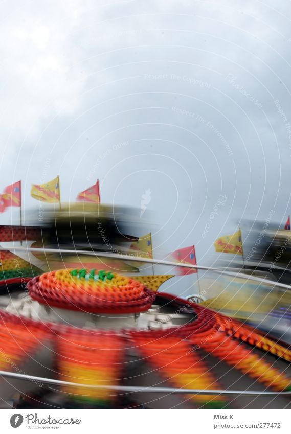 colourful Fairs & Carnivals Sky Speed Multicoloured Joy Theme-park rides Speed rush Flag Light Driving Movement Colour photo Exterior shot Copy Space top