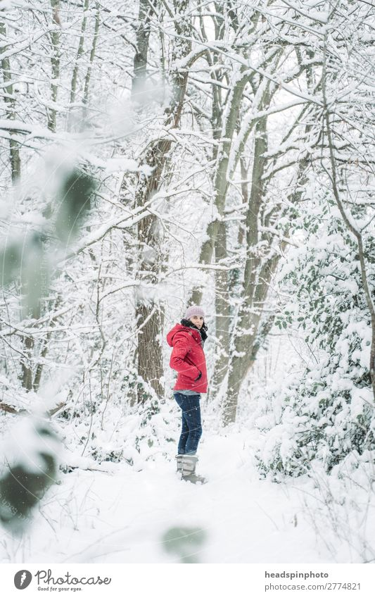 Woman with red jacket in the snow (forest) Joy Life Winter vacation Mountain Hiking Feminine Young woman Youth (Young adults) Adults 1 Human being Environment