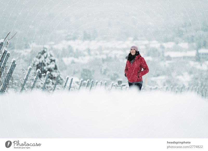 Woman with red jacket in snow-covered winter landscape Feminine Young woman Youth (Young adults) Adults 1 Human being Nature Landscape Winter Snow Snowfall