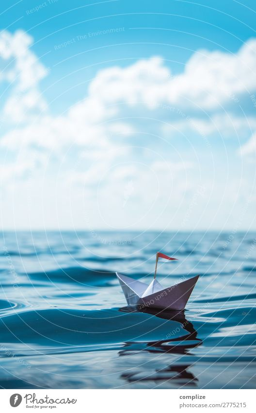 Small paper ship on a long voyage Leisure and hobbies Playing Handicraft Model-making Vacation & Travel Far-off places Summer vacation Sun Beach Ocean Waves