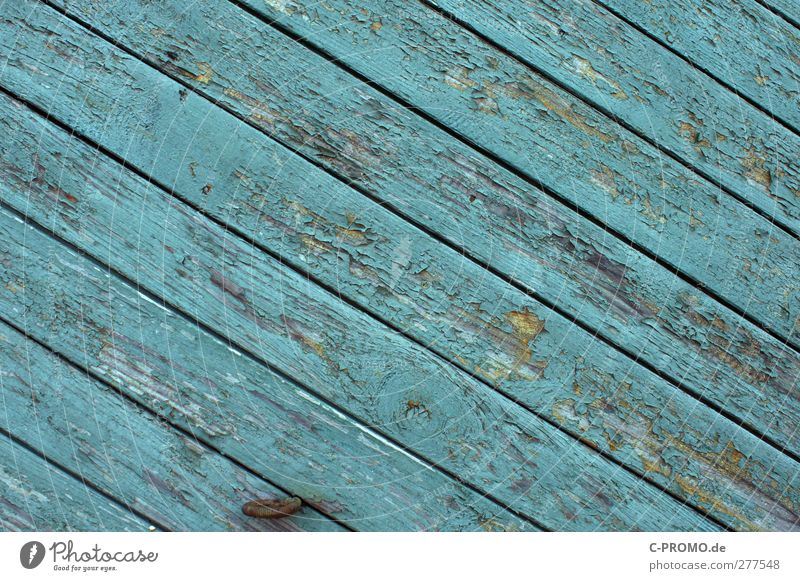 Industrial paint vs. wind&weather Facade Old Wooden board Turquoise Weathered Varnish Diagonal lattice fence Wooden wall Colour photo Exterior shot Deserted