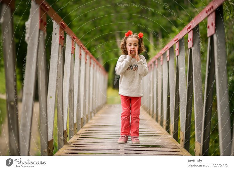 Cute little girl having fun in a rural bridge Joy Happy Beautiful Life Playing Child Human being Feminine Girl Infancy 1 3 - 8 years Nature Flower Bridge