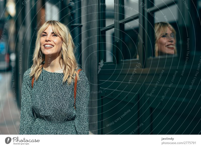 Smiling young blonde woman standing on urban background. Lifestyle Style Joy Happy Beautiful Hair and hairstyles Human being Feminine Young woman