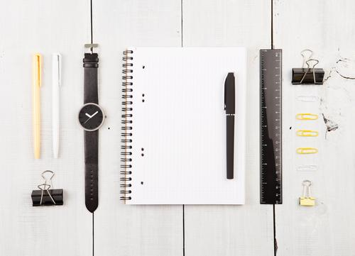 Workplace with notepad, watch, pens and other office supplies Reading Desk Table Work and employment Office Business Paper Pen Wood Line Observe Write Above
