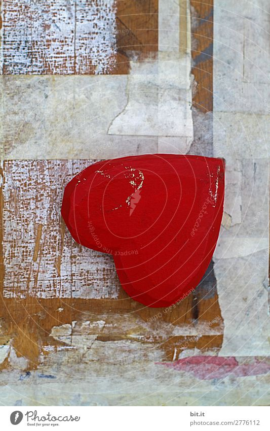 Red heart of wood with style lies as a still life, upside down on an old graphic, trashy white art background of wood, paint and paper. Feasts & Celebrations