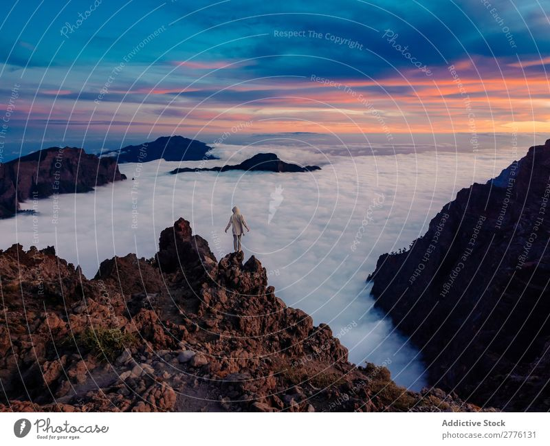 Person on high cliff above cloudsº Human being Clouds Mountain Cliff Dream Nature Mysterious Vacation & Travel
