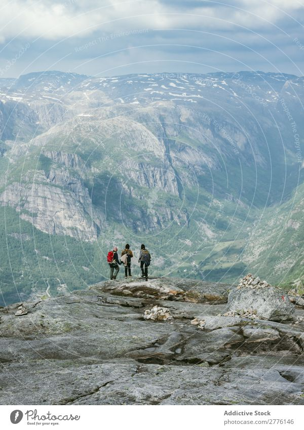 Tourists on background of mountains Human being Mountain Cliff Hiking Nature Group Vacation & Travel Picturesque