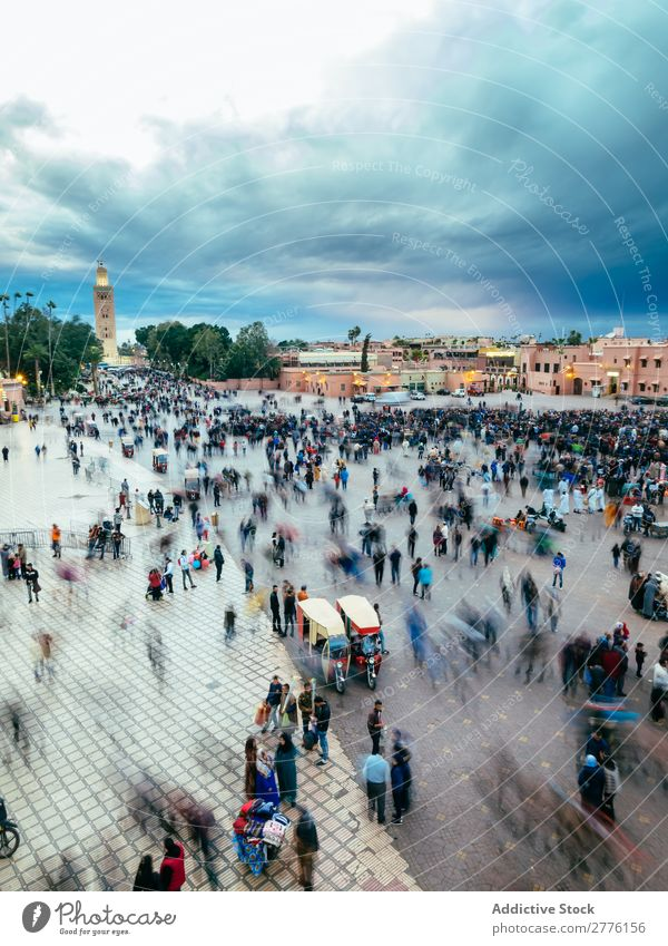 People on square in Marrakech, Morocco Skyline Square crowd Cloud cover in motion Town tourists Architecture City Vantage point Twilight Panorama (Format)