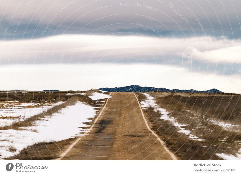 Snowy asphalt road Street Asphalt Field Vantage point Landscape Nature Sky Vacation & Travel Clouds Rural Winter Transport Countries Seasons way Cold Frost
