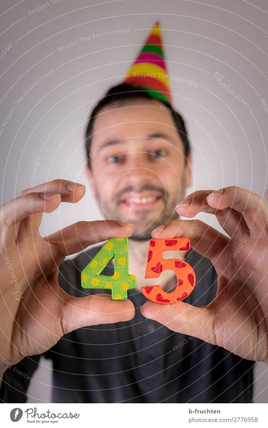 Man holding two numbers in his hand, party Party Event Feasts & Celebrations Carnival Birthday Adults Head Hand Fingers 1 Human being Hat Decoration