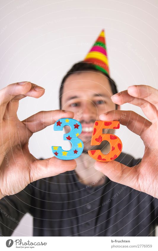35 years, anniversary celebration Business Career Success Man Adults Hand Fingers 1 Human being 30 - 45 years Hat Decoration Wood Digits and numbers Select