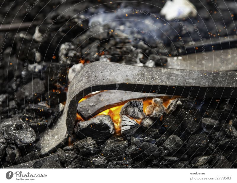 Iron incandescent in an old metal forge Shopping Work and employment Industry Craft (trade) Tool Hammer Hand Metal Steel Old Glittering Dirty Hot Bright Retro