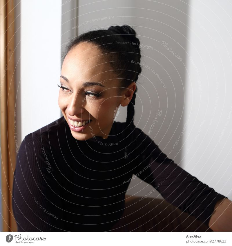 Portrait of a woman with braid Joy Beautiful Contentment Young woman Youth (Young adults) 18 - 30 years Adults 30 - 45 years T-shirt Black-haired Curl Braids