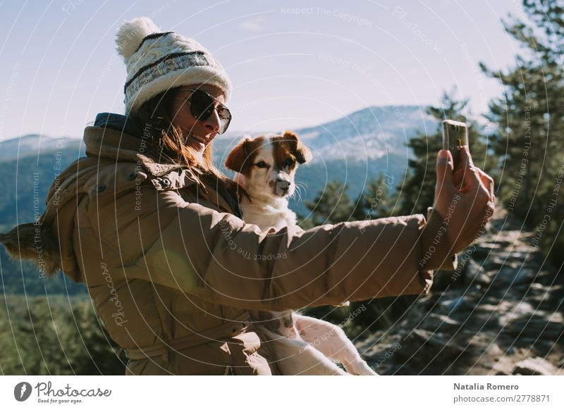 girl makes a selfie with her pet in the mountain Lifestyle Leisure and hobbies Adventure Freedom Snow Mountain Hiking Camera Technology