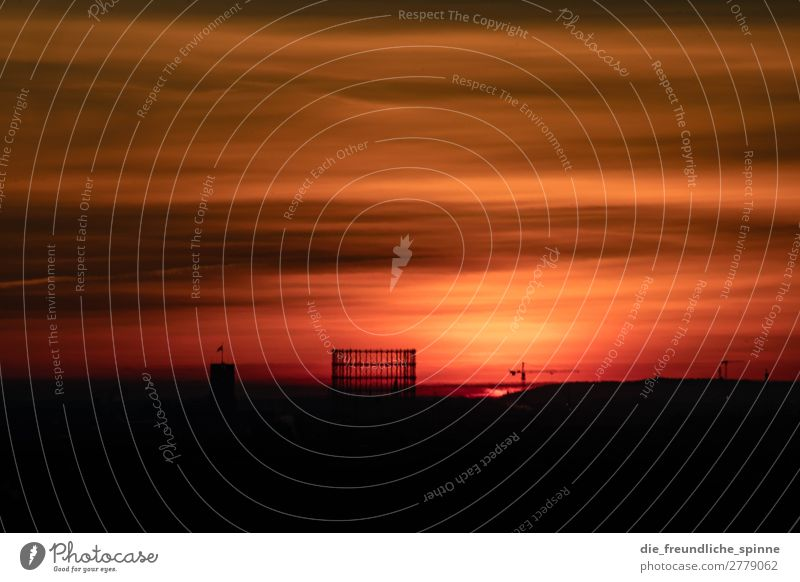 Sunrise over the Gasometer Landscape Sunset Sunlight Winter Berlin Germany Europe Capital city Downtown Skyline Manmade structures Architecture Yellow Orange