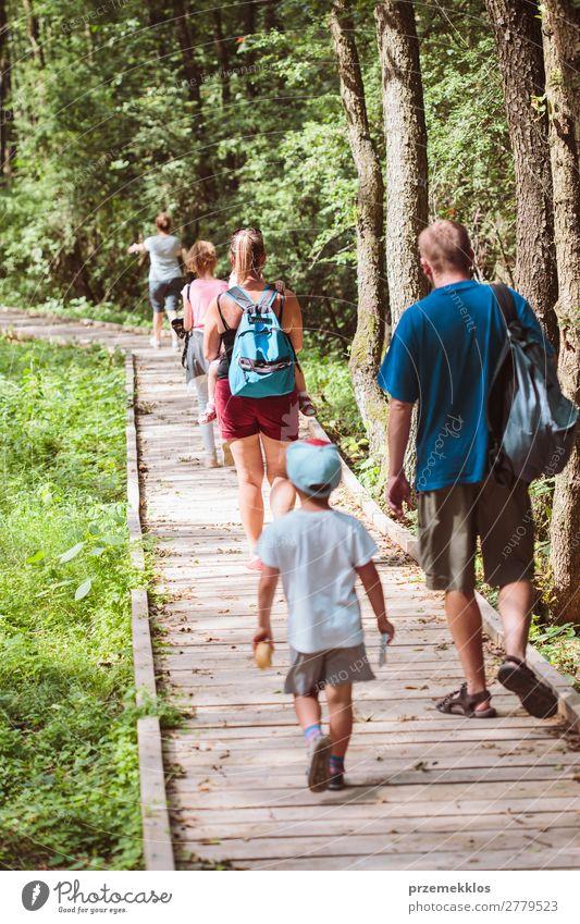 Family going a path in forest Lifestyle Vacation & Travel Trip Summer Child Boy (child) Woman Adults Man Parents Mother Father Family & Relations Infancy Nature