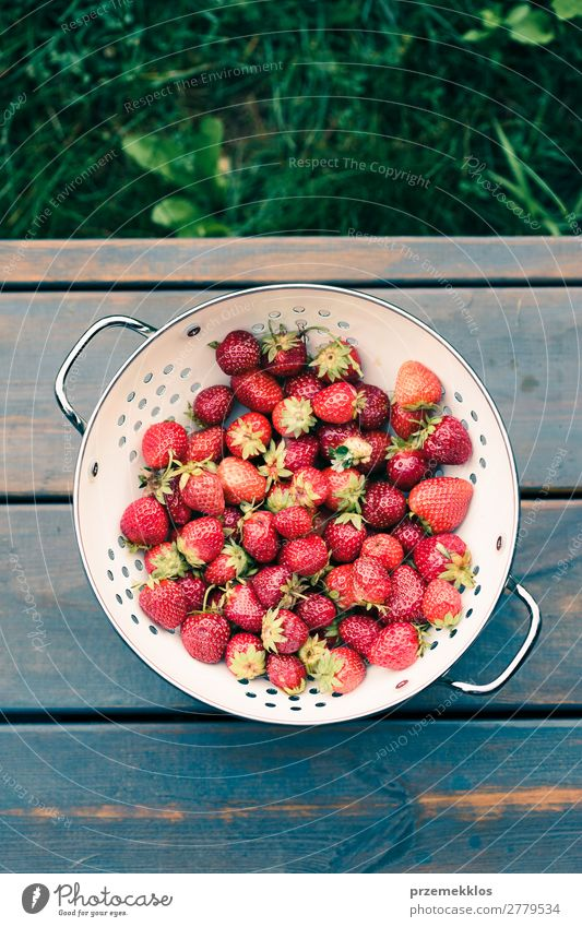 Bowl of fresh strawberries sprinkled raindrops on wooden table Nature Summer Red Wood Natural Fruit Fresh Table Delicious Vegetarian diet Mature Rustic