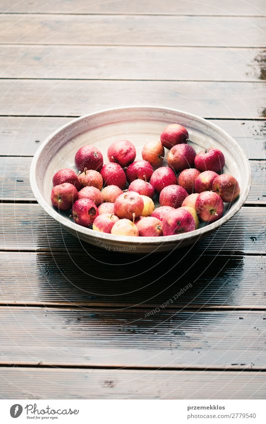 Closeup of big bowl of fresh red apples on wooden table Vegetable Fruit Apple Vegetarian diet Bowl Summer Table Nature Autumn Wood Fresh Delicious Natural Juicy