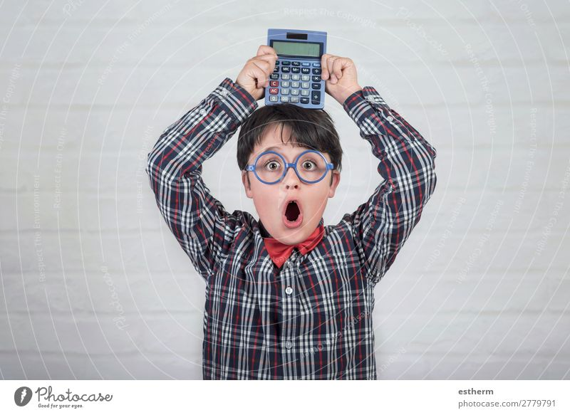 Happy student showing calculator over his head Child Human being Joy Lifestyle Funny Emotions School Think Masculine Technology Infancy Study Curiosity
