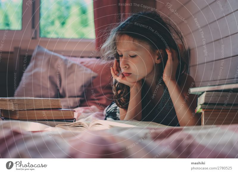 thoughtful kid girl reading book alone Lifestyle Reading Child School Infancy Book Communicate Loneliness Mysterious autism health autistic mental education