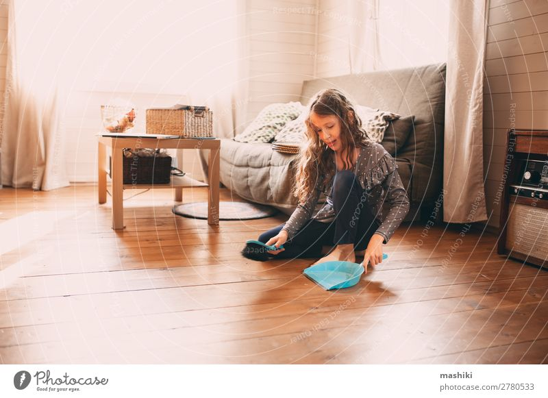 funny kid girl helping with housework Child House (Residential Structure) Joy Lifestyle Wood Funny Family & Relations Happy Small School Work and employment