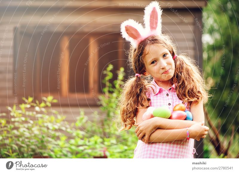 easter portrait of happy child girl in bunny ears Joy Happy Playing House (Residential Structure) Garden Feasts & Celebrations Easter Child Family & Relations