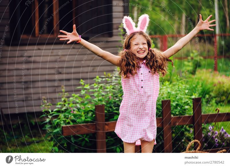 easter portrait of happy child girl in bunny ears Joy Playing House (Residential Structure) Garden Feasts & Celebrations Easter Child Family & Relations Infancy