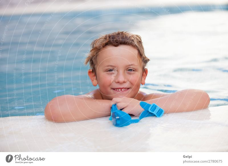 Funny blond boy in the pool Lifestyle Joy Happy Relaxation Swimming pool Leisure and hobbies Playing Vacation & Travel Summer Sports Child Human being