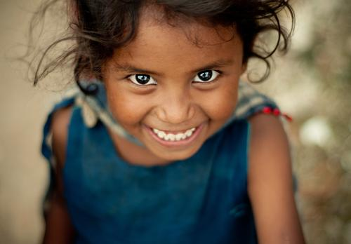 Human being Child Blue Red Girl Joy Far-off places Love Eyes Feminine Emotions Laughter Happy Head Brown Infancy