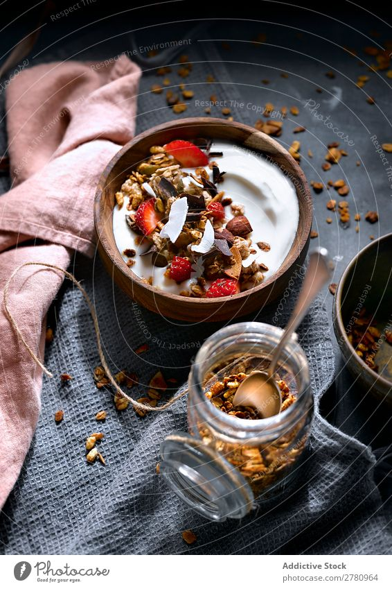 Delicious granola with coconut cream Cereal Coconut Cream Dessert Strawberry Healthy Food Sweet Breakfast Arrangement Refreshment Tasty Raw Fruit Meal Dried