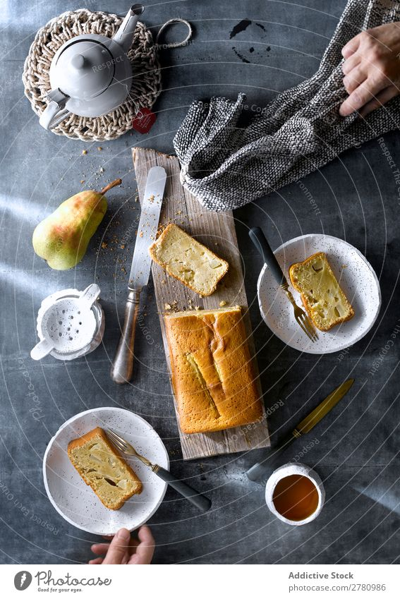 Flay lay of served freshly baked pear cake with tea on rustic table. Cake Teatime Set setting table Fresh Pear Eating Dessert Food Tradition Organic