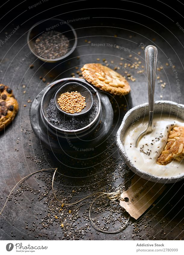 Yogurt with cookies and seed assortment Yoghurt Cookie Seeds Organic Mix chia seeds recipe poppy seeds Gourmet Conceptual design composition Rustic Arrangement