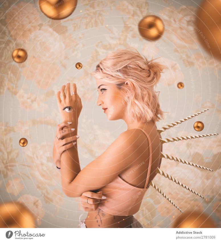 Pink haired woman with eye on arm and thorns in back Woman Spiral Vintage Eyes third eye pink hair Attractive beauitful Body Wild Conceptual design Head fancy