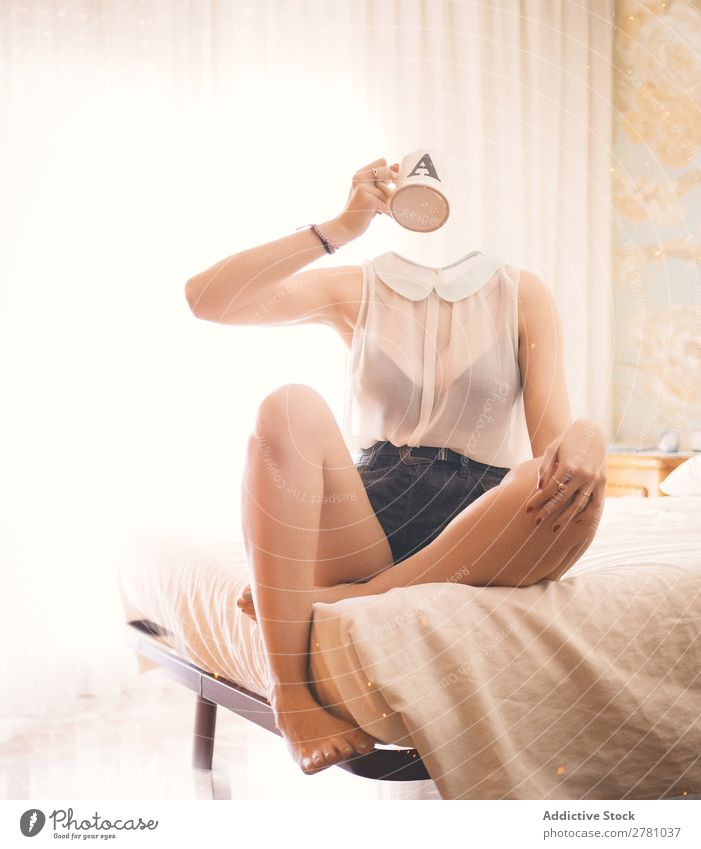 Headless woman siiting on bed and drinks Woman Faceless without head Cup Mug Liquid Beverage Hold Drinking Hand Arm Top White Transparent Denim pose Mystic
