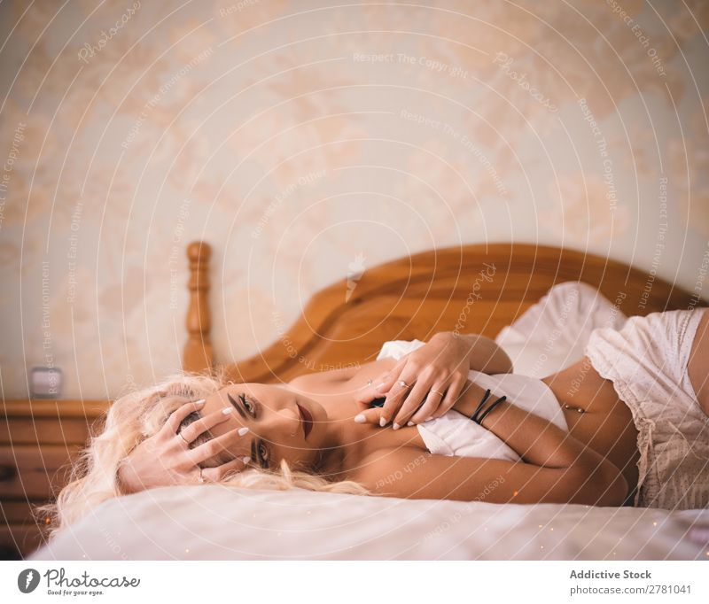 Pretty blonde woman lying on bed with crossed arms Woman beauitful Body Conceptual design third arm Head fancy Fantasy Flower Illusion nobody's Intellect Fairy