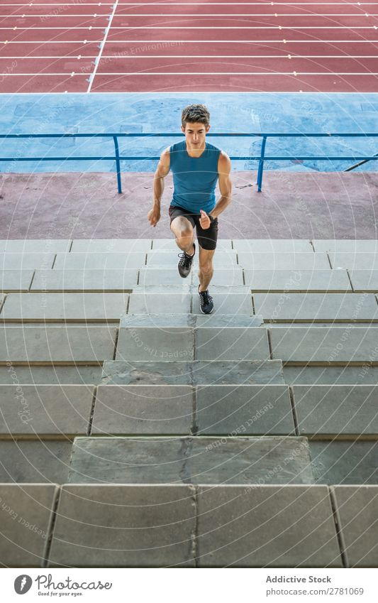 Sportsman running upstairs on stadium Man Stadium Running Stairs Fitness sportsman Practice workout Athletic Action Muscular Healthy sprint Youth (Young adults)