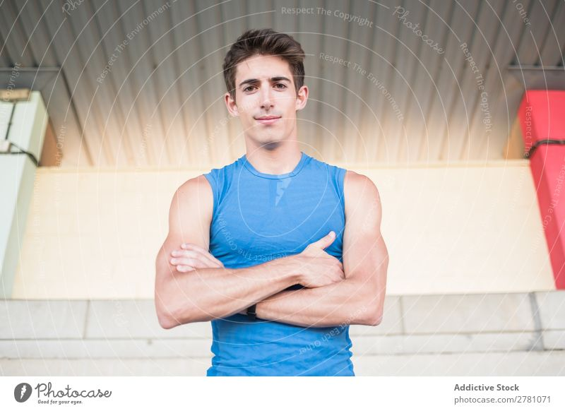 Muscular man posing at camera Man Stadium Posture Rest sportsman Sports Fitness hands crossed Practice Athlete Relaxation Adults Sprinter Break Sportswear