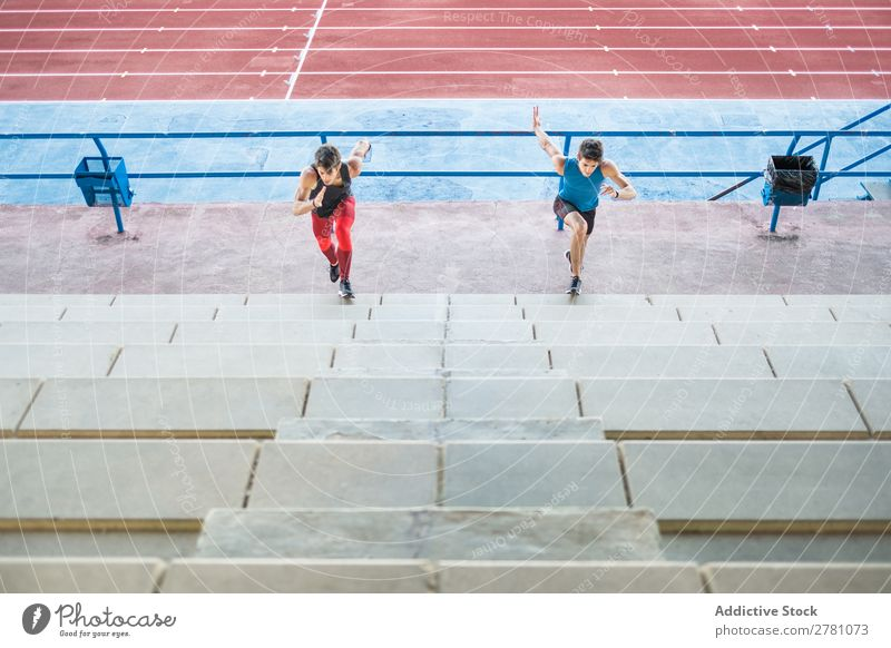 Two sportsmen running up stairs Stadium Running Stairs Fitness Practice workout Athletic Action Muscular Healthy sprint 2 Youth (Young adults) Athlete Sports